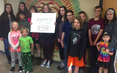 Youth who walked in this year's C.R.O.P. walk presented a check for $4,598 to th…